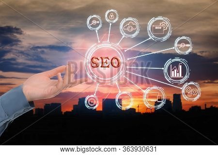 Woman Demonstrating Directions Of Seo. World Globe With Icons Of Keyword Research, Customization And