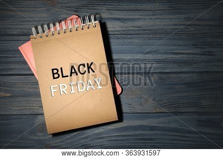 Stylish Notebooks On Dark Wooden Table, Top View With Space For Design, Black Friday Sale