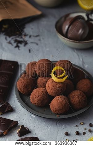 Close-up Of Chocolate Truffles With Black Pepper And Lemon Zest