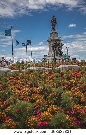 Quebec City, Canada, July 2012 - Visitors In The Flowery Park Flocking Around The Monument Of Samuel
