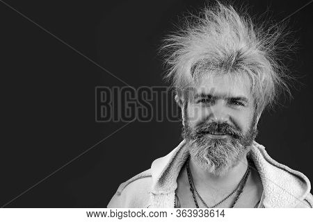 Goofy Young Man, With Full Beard And Moustache And Wild Hair, Pull A Comical Face To The Camera. Spa