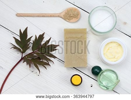 Ingredients For Homemade Facial Mask. Coconut Oil, Shea Butter, Essential Oil, Natural Soap And Bent