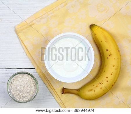Ingredients For Homemade Facial Mask, Top View. Banana, Plain Yogurt And Finely Ground Oat.