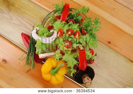 image of vegetables in salad on wood