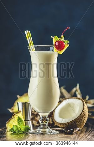Glass Of Tasty Frozen Pina Colada Traditional Caribbean Cocktail Decorated By Slice Of Pineapple And
