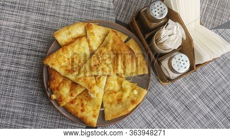Georgian Dish - Megrelian Khachapuri. As A Filling, Young Imeritin Cheese Is Used. The Salt And Pepe