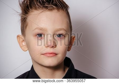Portrait Of A Handsome Guy With Different Emotions On A White Background