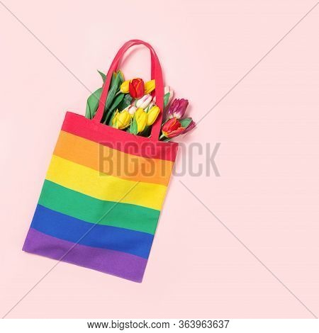Lgbtq Pride Rainbow Flag Canvas Tote Bag With Tulip Flowers On Pink. Top View Flat Lay. Homophobia,