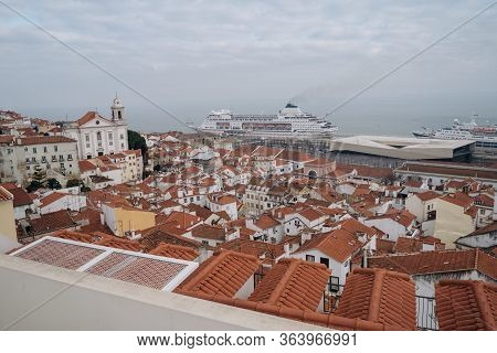 View Of Alfama, The Oldest District Of The Old Town, With National Pantheon From Belvedere. Lisbon,