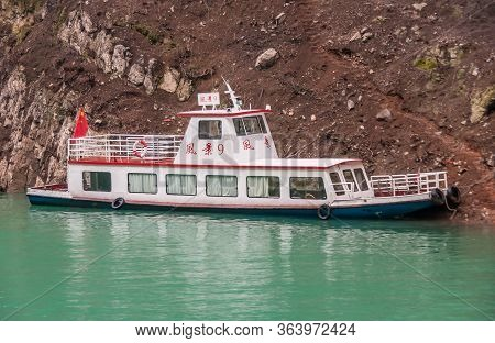 Wuchan, China - May 7, 2010: Dicui Or Emerald Gorge On Daning River. Small White Passenger Boat Moor
