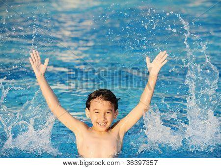 Children splashing in water enjoying at summertime