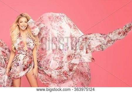 Sensual Blonde Woman In Floral Maxi Dress.