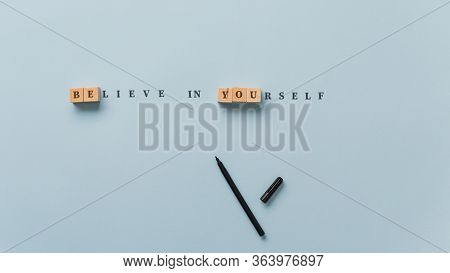 Believe In Yourself Sign Spelled In Combination Of Wooden Blocks And Letters On Paper With Emphasis