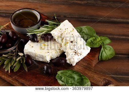 Greek Cheese Feta With Rosemary And Olives. Healthy Ingredient For Cooking Salad. Chopped Goat Feta