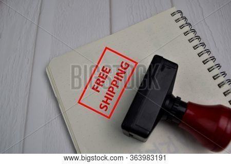 Red Handle Rubber Stamper And Free Shipping Text Isolated On White Background.