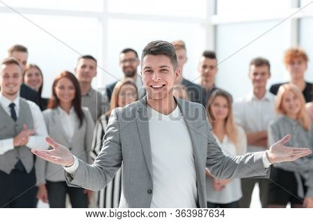 confident Manager standing at the front of the business team
