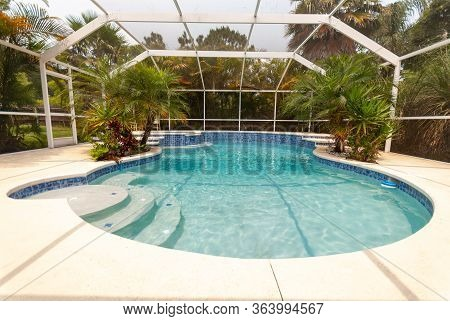 Enclosed Backyard Residential Pool In South Florida