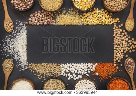 Different Type Of Raw Dry Legumes Composition. White Beans, Lentils, Bulgur, Chickpeas, Kidney Beans