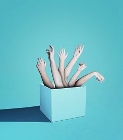 Multiple Hands Reaching Out Of The Box . Hire Team Recruits Concept . Crowd Funding Group .