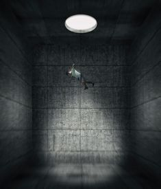 Man Falling Through A Hole To A Dark Concrete Room . Isolation And Lockdown Concept .