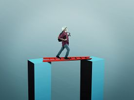 Young Man Walk On A Ladder Between Two Cubes . Risk Taking . Overcoming Obstacles Concept .