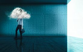 Businessman Walking On A Modern Blue Background With A His Head In A Cloud.