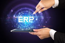 Close-up of a touchscreen with ERP abbreviation, modern technology concept