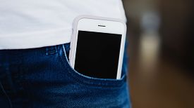 Smartphone With Screen In Blue Jeans Pocket