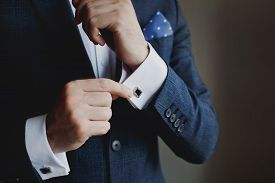 Close-up Of A Man In A Tux Fixing His Cufflink