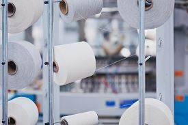 Knitted Fabric. Textile Factory In Spinning Production Line And A Rotating Machinery And Equipment P
