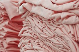 Material On The Textile Factory. Rolls Of Industrial Cotton Fabric For Clothing Cloth Textile Manufa