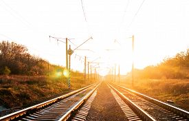Electrified Railway On Sunset Background