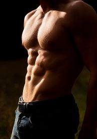 Sensual Mans Body. Torso With Six Packs Looks Attractive On Black Background. Handsome Man Muscular