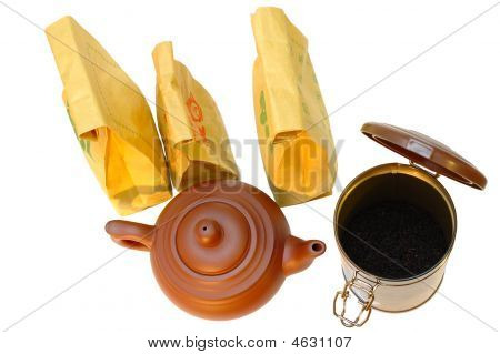Chinese pottery (clay) teapot tea in paper bags and tin on isolated background. poster