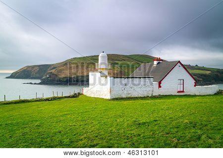 Small lighthouse on the coast of Ireland