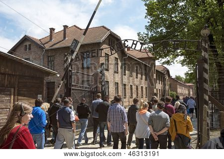 OSWIECIM - MAY 26: Tourists at the entrance of the concentration camp in Oswiecim, Poland on May 26, 2013. Oswiecim was the largest German concentration camp on Polish territory during World War II.