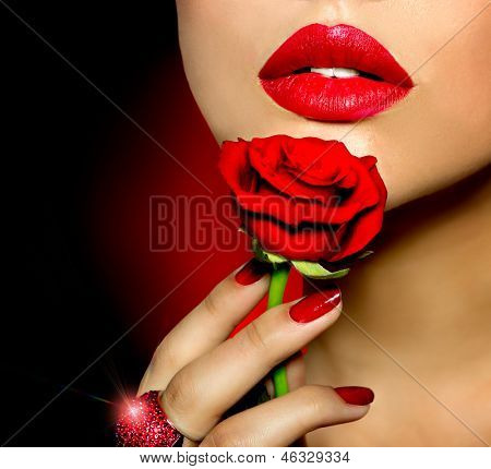 Beautiful Red Lips, Nails and Rose Flower. Beauty Girl. Makeup and Manicure. Sensual Mouth. Sexy Red Color Lips. Part of Face
