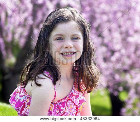 Happy Little Girl Outside In A Park