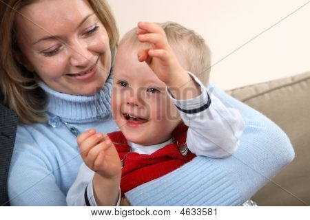 Portrait Of A Mother And Her Son With Down Syndrome.