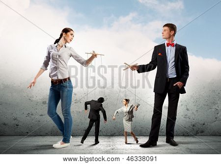 Businesspeople with marionettes