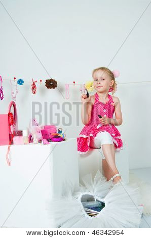 Elegant Girl Playing With Cosmetics And Jewelry
