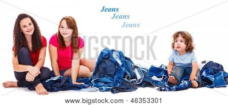Teenage girls and a toddler sitting among jeanswear