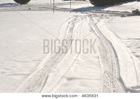 Driveway With Tire  Tracks In Snow