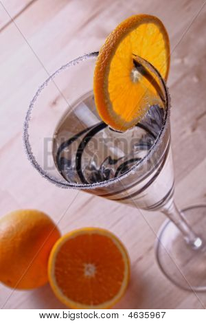 Frosted Glass With Oranges And A Cocktail Drink