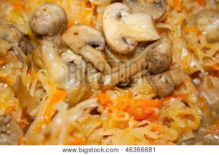 Fried cabbage with mushrooms.