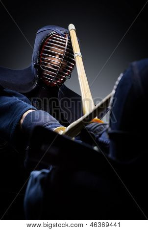 Close up view of competition of two kendo fighters. Japanese martial art of sword fighting