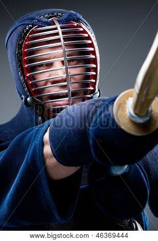 Close up of kendo fighter training with shinai. Concept of Asian martial arts