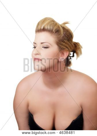 Young Woman With Low Cut Dress Showing Cleavage
