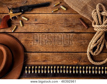 Western accessories on wooden table - Frame west poster