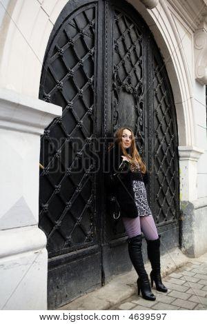 Woman And Black Door